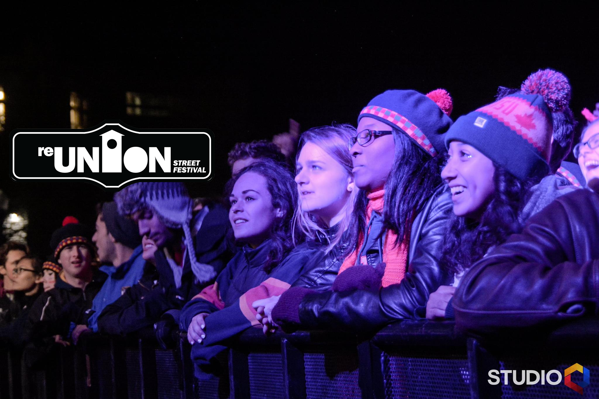Image of students watching the reunion street festival concert in the front row